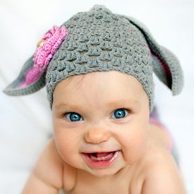 stock photo of baby sheep  - Happy baby in the hat like a bunny or lamb - JPG