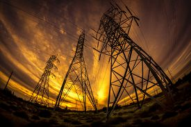 picture of electricity pylon  - Electricity power pylons at sunset - JPG