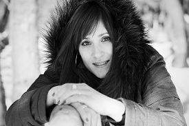 stock photo of grayscale  - Closeup portrait of a pretty woman in winter in grayscale - JPG