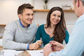 picture of family planning  - Young couple meeting financial advisor for investment