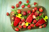 stock photo of strawberry  - strawberries strawberry ice cream on a wooden board strawberries scattered on the board - JPG