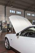image of muscle-car  - car with the hood open in repair workshop - JPG