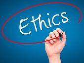 pic of ethics  - Man hand writing Ethics on visual screen - JPG