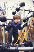 stock photo of preteen  - preteen handsome boy train in outdoor gym training ground. ** Note: Visible grain at 100%, best at smaller sizes - JPG