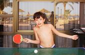 picture of preteens  - preteen handsome boy play table tennis in the beach resort hotel recreation area - JPG