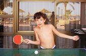 image of preteen  - preteen handsome boy play table tennis in the beach resort hotel recreation area - JPG