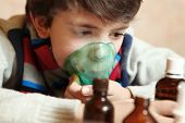 picture of inhalant  - boy with electric inhaler as a curation against virul disease flue - JPG