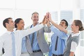 picture of cheers  - Portrait of cheerful business people cheering in the office - JPG