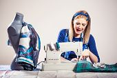 picture of thread-making  - Woman sews and realizes that she is making mistake - JPG