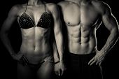 picture of fitness man body  - Fitness couple poses in studio  - JPG
