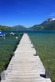 stock photo of annecy  - wooden pontoon on Lake Annecy in France - JPG