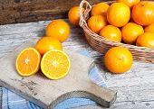 stock photo of valencia-orange  - still life of oranges on wicker and wood background - JPG