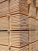 picture of lumber  - Stack of new wooden studs at the lumber yard - JPG