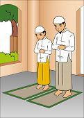 stock photo of pray  - Father and son praying in mosque together - JPG
