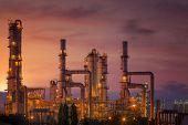 picture of greenpeace  - Oil refinery at twilight sky close up to pipe line - JPG