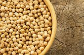 pic of chickpea  - bunch of chickpeas in a bowl on old wooden background - JPG