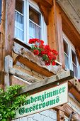 picture of guest-house  - Guest Rooms Sign on wooden board on a guest house in the Black Forest - JPG