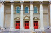 foto of church  - Welcoming red church doors behind large columns taken at a church - JPG
