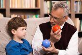 image of psychologist  - Little boy talking with psychologist - JPG