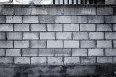 image of cinder block  - A blank grungy cinder block wall perfect for background and messages - JPG