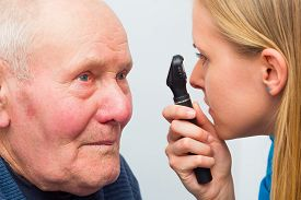 foto of cataracts  - Optician consulting elderly patient with cataracts and other eye problems - JPG