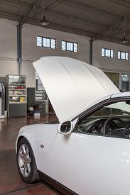 foto of muscle-car  - car with the hood open in repair workshop - JPG