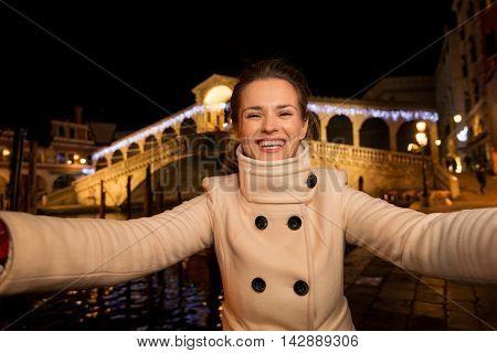 Woman Taking Selfie Near Rialto