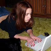 Young Teen Girl Typing On Laptop