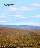 Airplane Over Desert
