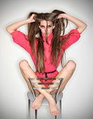 Funny Confused Emotion Woman In Pink Blouse Holding Long Tousled Hairs, Ring Flash Studio Portrait O