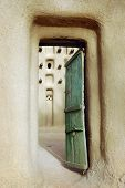 pic of dogon  - A vertical view of an entrance door into a mud mosque in a Dogon village in Mali - JPG