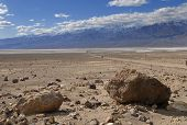 image of sandstorms  - Red rocks and stones on the dry bottom of Death Valley - JPG