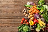 Assortment of  fresh vegetables  on wooden background poster