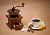 Coffee grinder And Cup Of Hot Coffee