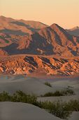 The Sunset Over The Dunes And Mountains In Death Valley, California, Usa
