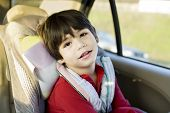 Little disabled boy in car seat