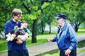 picture of physically handicapped  - Three generations interacting together - JPG