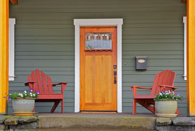 foto of front door  - Mission style Stained wood front door with beveled glass surrounded by two Adirondack chairs and flowers - JPG