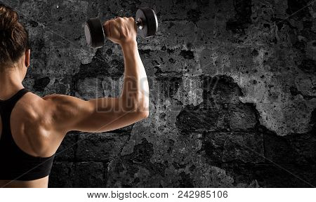 Athletic Muscular Woman Training Biceps