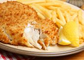 Breaded haddock fillets with crispy fries.