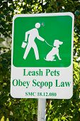 stock photo of pooper  - Leash pets and Obey scoop law sign - JPG