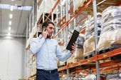 wholesale, logistic business, technology and people concept - businessman calling on smartphone at w poster