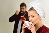 Couple. Loving Couple Having Breakfast. Romantic Couple Eating Breakfast - Cute Woman Enjoying Coffe poster