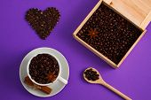 Cup Of Coffee Seeds, Cinnamon, Anis Coffee Heart Shapes, Wooden Box And Spoon With Coffee    On Purp poster