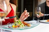 picture of tartar  - Couple for romantic Dinner or lunch in a gourmet restaurant drinking wine and eating - JPG