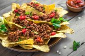 Mexican Nacho Corn Tortilla Chips With Cheese, Meat, Guacamole And Red Hot Spicy Salsa. Nachos With  poster