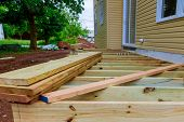 A Installation Wooden Deck Or Patio New Home, Timber Deck Being Constructed poster