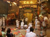 AMPANG, MALAYSIA â?? OCT 05: Taoist devotees chant, meditate and pray at the main hall of the Lam Th
