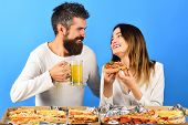 Romantic Couple Drinks Beer With Pizza At Home. Loving Couple Sitting At Table Enjoy Pizza. Loving C poster