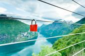 Tourism Vacation And Travel. Red Love Lock Padlock On Bridge And Mountains, View Over Magical Geiran poster